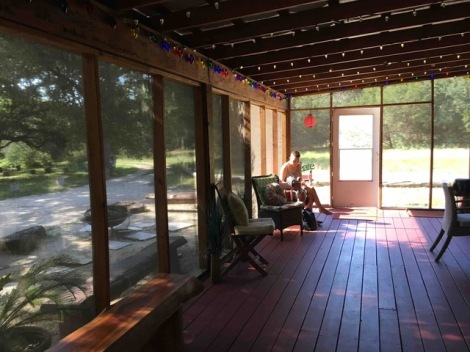 Writer on Sunlit Porch